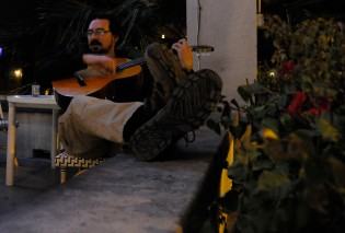 Adrian Fontes, 43, plays a guitar while sitting on the porch of his store, Bodega 420, on Roosevelt and Fifth streets on Wednesday, Nov. 27. Fontes owns a store, practices law and is running for the District 24 House of Representatives seat in the 2014 election.