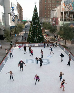 People skate outside on the temporary ice rink on Central Avenue between Washington and Jefferson streets on Sunday, Dec. 1. The rink opened on Nov. 24, the same day as the Christmas tree lighting, and will close Jan. 5.