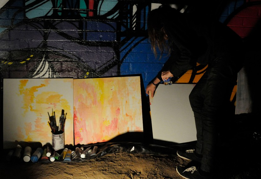 At First Friday art walk in downtown Phoenix on Nov. 1, Travis Vallance sets up three canvases that he plans to paint on during the night. Vallance said he mainly sells his artwork at First Fridays.