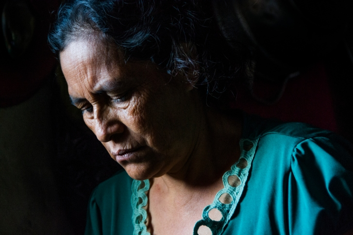 Bertha Maria López uses light from the window to cook breakfast on March 10, 2015 in Sabana Grande, Nicaragua. López works in the solar-powered restaurant in her community and makes $20-40 a month. Danika Worthington/JMC 470