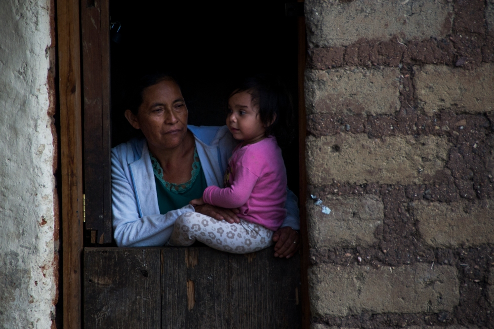 Bertha Maria López stands in the kitchen doorway with her granddaughter, Samantha Noely Martínez, on the morning of March 10, 2015 in Sabana Grande, Nicaragua. Martínez stays with López while her mother, who is sick, is treated in the city. Danika Worthington/JMC 470