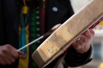 Klee Benally of the Navajo Nation plays a drum while leading other protesters in a chant against uranium mines outside the Environmental Protection Agency in Washington, D.C., on Friday, Jan. 29. (Danika Worthington/Cronkite News)