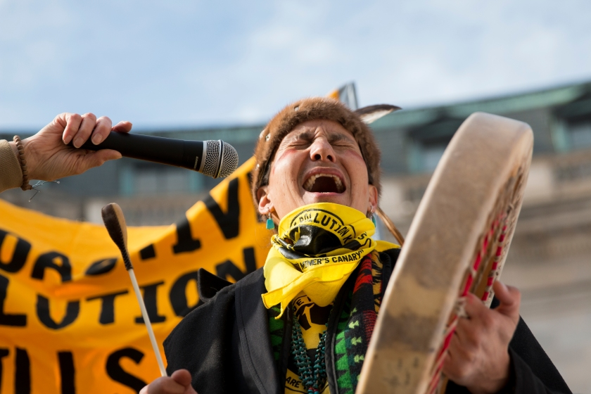 Klee Benally of the Navajo Nation sings during a rally against pollution from abandoned uranium mines outside the Environmental Protection Agency in Washington, D.C., on Friday,  Jan. 29. (Danika Worthington/Cronkite News)